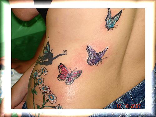 tattoos de flores. tatuagem borboletas e flores