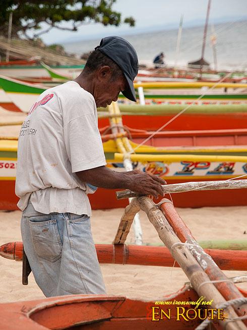 Manong tightening the knots
