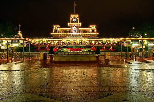 disney main street train station at night with christmas decorations
