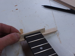 ...to indicate the top of the fretboard...