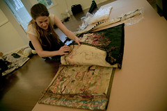 Sandrine unwrapping her work. (fette's gallery) Tags: thread fabric installations soloexhibition fettesgallery sandrinepelletier swissartist