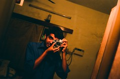 i super like the blue.. and 35mm is sooo different from a medium format TLR! (bavan.prashant) Tags: blue portrait colour home up mirror fuji madras handheld 17 canonet f4 reala sleepdeprived keeping selfie appearances badscan dimlight ql longfingers 14sec shookthedamnphotograph
