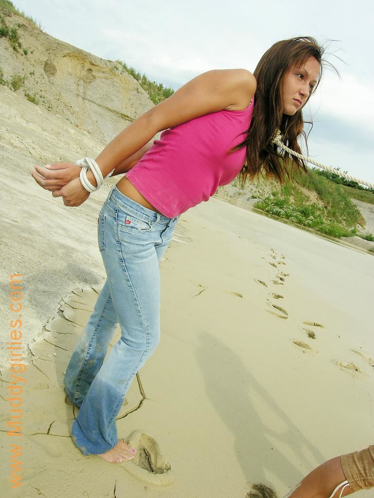 Barefoot girl in jeans