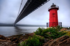The George Washington Bridge and the Little Red Lighthouse (mudpig) Tags: park nyc newyorkcity bridge red lighthouse mist newyork beach fog geotagged newjersey manhattan lane hudsonriver gothamist georgewashington hdr gwb fortlee georgewashingtonbridge riverscape mudpig stevekelley stevenkelley