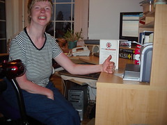 Glenda giving the ProBlogger book a thumbs up