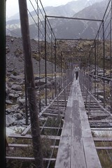 crossing bridge at Mt Cook, NZ 1975 (Blue-yonder) Tags: newzealand southisland suspensionbridge mountcook