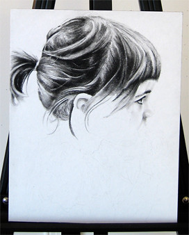 In progress photo of carbon pencil drawing entitled Clara, Profile