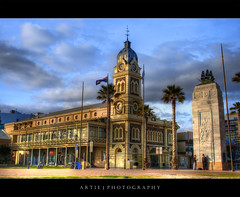 The Glenelg Town Hall - HDR (:: Artie | Photography ::) Tags: sky cloud colour building clock monument architecture photoshop canon design sandstone colours cs2 tripod kitlens australia courtyard flags structure adelaide townhall 1855mm southaustralia glenelg efs hdr artie 3xp photomatix tonemapping tonemap 400d rebelxti