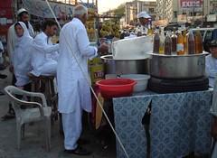 unhealthy treats (tango 48) Tags: pakistan red people ice water glass chair sweet almonds sherbet islamabad rawalpindi