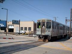 Southbound CTA Yellow line / Skokie Swift train crossing Main Street. Skokie Ilinois USA. April 2007.