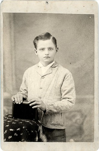 Boy in sweater with book