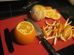 Peeling the oranges