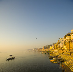 Sunup at Kashi (sapru) Tags: morning travel sunset india tourism water sunrise river boats religious dawn boat still cool fantastic quiet peace religion transport relaxing scenic restful calming surreal floating peaceful tranquility calm silence harmony transportation rivers serenity varanasi destination serene fabulous dreamlike hush kashi stillness pilgrimage tranquil balanced poised gentle ganga soothing calmness ganges quietness ghats banaras comforting pilgrims benaras composed ghat otherworldly illusory boatmen unruffled untroubled unperturbed unworried trancelike