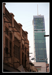 Bahrain Between (Past & Present) (Al-Kooheji) Tags: old travel building modern buildings bahrain traditional culture present past manama           alkooheji