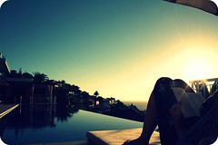 the reader (FlavioSarescia) Tags: africa sunset sun pool girl sunshine reading book capetown clich hcs