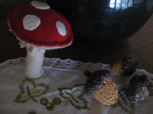 toadstool and knitted acorns on the nature table