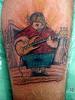 Tatuagem baixista TARZIA TATTOO -