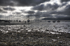 More boats (abstract_effects) Tags: sky mountains seaweed reflection water wales clouds canon dark boats eos pier july lowtide sunrays beaumaris 2008 1022mm wfc anglesey northwales gogleddcymru 40d impressedbeauty abstracteffects