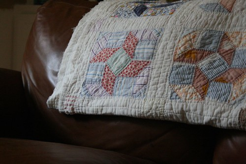 old quilt on love seat