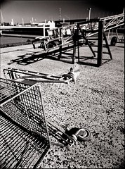 necromechanics (mugley) Tags: city bridge urban blackandwhite bw 120 film metal docks mediumformat shopping concrete shadows kodak pavement trolley steel trix wheels grain australia melbourne victoria 400tx frame epson docklands polarizer 6x45 vignetting vignette urbanlandscape redfilter polariser kodaktrix400 25a v700 mamiya645protl northwharf 35mmf35sekorn