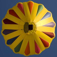 Sunrise (Neon Ibis) Tags: pink blue red summer orange black green yellow sunrise purple balloon violet hotairballoon fusia chatfieldstatepark dsc0046 nikkor18200mmf3556gifed rockymountaingballoonfestival
