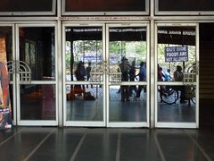 Doorknobs - Metro Cinema - Kolkata (Calcutta), India (John Meckley) Tags: india cinema art film architecture movie hall asia theater theatre metro indian m doorknob artdeco deco kolkata calcutta southasia westbengal cinemahall