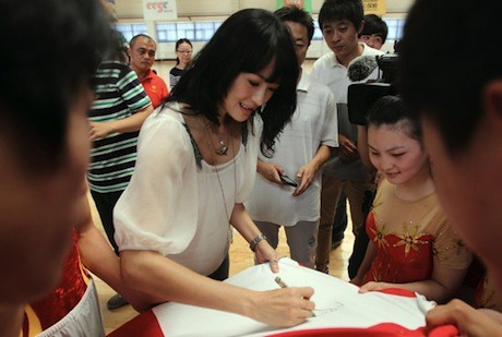 June 19, 2011 - Chinese actress Zhang Ziyi meets the Chinese gymnastics team headed to the Special Olympics in Athens