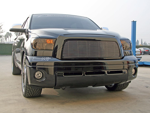 Smoked headlights and a billet grille make the Tundra look mean.