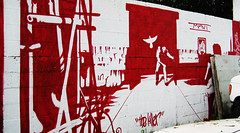 The Killer (Meadaura) Tags: street red urban white streetart black art monochrome painting movie asian graffiti mural paint downtown miami great chinese inspired dramatic murals tags monochromatic spray godfather johnwoo filmstrip 305 chowyunfat cp1 thekiller artbehindfences