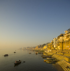 Boats on the banks of river Ganga, Kashi (sapru) Tags: morning travel sunset india tourism water sunrise river boats religious dawn boat still fantastic quiet peace religion transport relaxing scenic restful calming surreal floating peaceful tranquility calm silence harmony transportation rivers serenity varanasi destination serene dreamlike hush kashi stillness pilgrimage tranquil balanced poised ganga soothing calmness ganges quietness ghats banaras pilgrims benaras composed ghat otherworldly illusory boatmen holycity uttarpradesh watertransport passengerboat unruffled waterbody untroubled unperturbed worldbest unworried dazzlingshots trancelike passengerboats unlimitedphotos ourmasterpieces rubyphotographer vipveryimportantphotos dblringexcellence