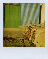 bike full of color (shawara) Tags: blue color film bike polaroid sx70 bicicleta playa 600 bici almeria cabodegata instantphoto ndfilter instantnea panpola