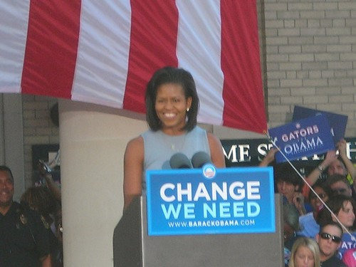 Michelle Obama flashes her smile to the Gainesville crowd.