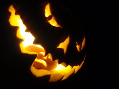 jack-o-lantern (om nom nom nom) (Thomas Powers) Tags: food holiday plant halloween smile face dinner pumpkin store nice eyes little eating jackolantern 10000villages jimmy contest evil snack cannibal tmp contestant mrjack surefire justate carveing villagemarketplace omnomnomnom olympusstylus1010 bloggedhalloween