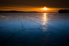 Merrimac Ice (Loren Zemlicka) Tags: november blue autumn trees winter light sunset shadow sky orange lake black cold reflection fall ice nature water ferry wisconsin clouds canon landscape evening frozen midwest seasons dusk horizon hills freeze 5d 40mm cracks distance 2008 wi canonef1740mmf4lusm yello merrimac lakewisconsin canoneos5d flickrexplore portalwisconsinorgselected lorenzemlicka portalwisconsinorg120308