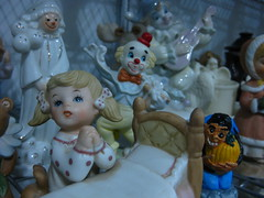 Dear Jesus, please save me from the clowns (and the weird ogre) (Opal in the rough) Tags: girl store junk treasure praying figurines thrift clowns goodwill knickknack
