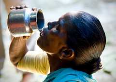 Thirsty woman drinking water - India (Eric Lafforgue) Tags: india water democracy drink profile indie indi indien hind indi inde southindia hodu southasia indland  hindistan indija   ndia hindustan  7011  lafforgue   ericlafforgue hindia  bhrat  indhiya bhratavarsha bhratadesha bharatadeshamu bhrrowtbaurshow  hndkastan