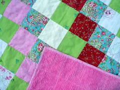 detail of girly patchwork quilt with chenille back