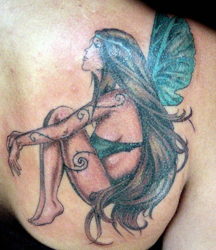 tattoos de alas. upper back tattoos