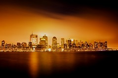 night fall (mudpig) Tags: world park city nyc newyorkcity longexposure ny newyork building fog skyline night buildings river geotagged gold golden newjersey nikon jerseycity long exposure downtown view nocturnal skyscrapers manhattan battery nj center hudson financial exchangeplace skycraper hyattregency d300 skyscrape mudpig stevekelley