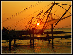 Fishing nets at sunset (Robin George) Tags: sunset india kerala cochin fortcochin chinesefishingnet impressedbeauty robingeorge goldstaraward natureselegantshots