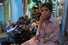 Boy selling shoes in Chabahar (unicefiran) Tags: unicef city kids project children countryside kid education child iran health need protection equality nutrition empowerment disparity