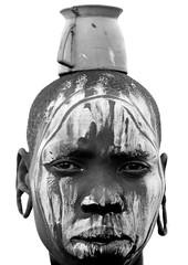 Mursi woman Ethiopia (Eric Lafforgue) Tags: africa portrait glass face artistic head dam african tribal ornament bodypainting ethiopia tribe ethnic rite barrage mursi tribo adornment pigments omo eastafrica thiopien etiopia ethiopie etiopa 3696 lafforgue  etiopija ethnie ethiopi  etiopien etipia  etiyopya  southethiopia nomadicpeople      salinicostruttori    gibeiiidam gibe3dam bienvenuedansmatribu peoplesoftheomovalley