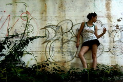 066 ~ Nine in the Afternoon (Photography by Brea) Tags: green girl grass leaves graffiti dance thea grafitti tank top grunge growth dirt whale shorts hip grime