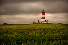 The Watcher in the rye (Jacqueline Harte) Tags: lighthouse field dark redwhite norfolk brooding 2008 happisburgh aplusphoto jacquelineharte artinoneshot