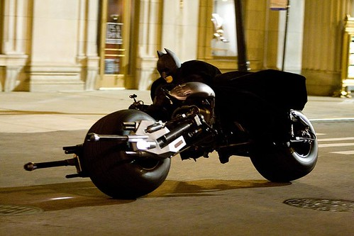 Christian Bale as Batman on the Batpod