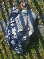 Found down at the landfill site: grey nylon jacket (longyman) Tags: abandoned rotting trash found clothing junk coat away clothes jacket rubbish waste discarded nylon landfill thrown padded rotted thrownaway nyloncoat nylonjacket