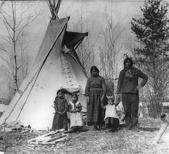 Aboriginal family near Prince Albert, SK, 1919 (Muse McCord Museum) Tags: girls canada kids children father mother tent apron firstnations braids saskatchewan teepee aboriginal plaid pinafore tipi mccordmuseum musemccord commons:event=commonground2009