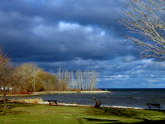 The Bay View (**Ms Judi**) Tags: blue trees sky water beautiful grass clouds waves shadows michigan ominous awesome great gray relaxing peaceful bluesky scene lovely sunlit capture soothing menominee potofgold lightlight msjudi peacefulview benchbenches judistevenson menonineemichigan thebayview