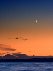 Strangford sunset and moon (Ian Humes) Tags: blue winter sunset orange moon water lough crescent northernireland mournemountains countydown strangford mournes goldstaraward