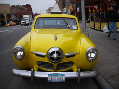studebaker front (omoo) Tags: auto newyorkcity car yellow vintage airplane automobile taxi champion westvillage studebaker streamlined greenwichvillage mexicanrestaurant influence twodoor tacotaxi calientecabcompany 195051 aircraftinspired seventhavesouthatbleeckerstreet